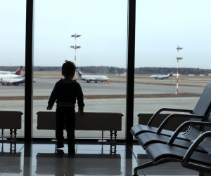 A Filipino child staring at the airplanes at the airport